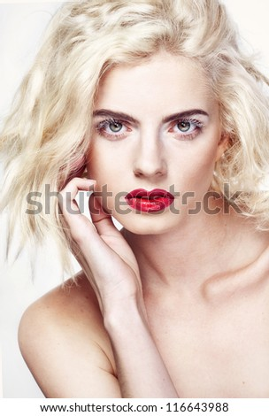Image with beautiful blonde girl with red lips on white background close-up - stock photo