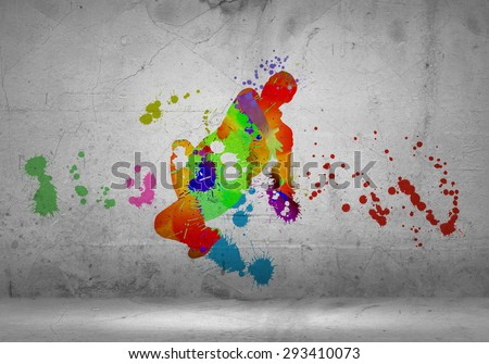 Image with color silhouette of dancer on gray wall