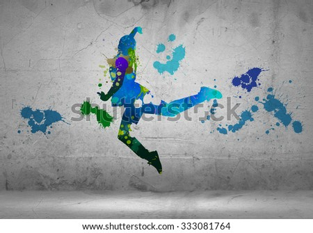 Image with color silhouette of dancer on gray wall - stock photo