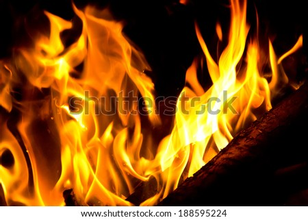 Image with red flame on black background