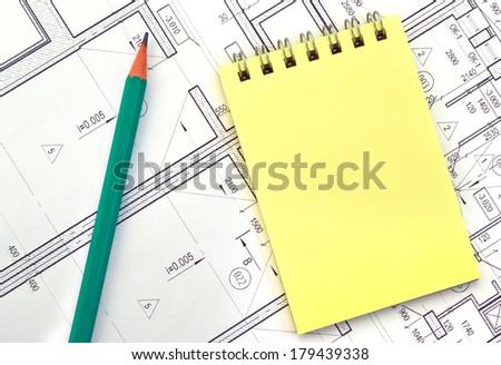 Image yellow notebook on the background of the drawing/Notebook on the background of the drawing  - stock photo