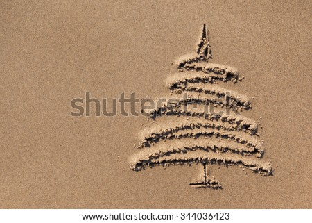 images christmas tree in the sand beach coastline close-up