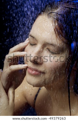 Images of a beautiful girl in the water and spray