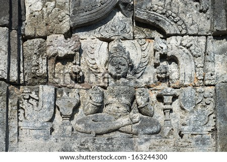 Images of Buddha on wall of temple in Candi Sewu complex (8th Century). Candi Sewu means 1000 temples, which links it to the legend of Loro Djonggrang. temple in Java, Indonesia.