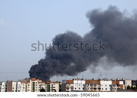 Images of smoke from a fire in the city. - stock photo