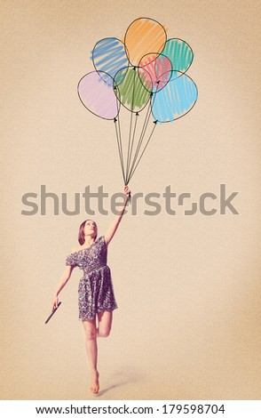 imagination. young woman is flying away with drawn balloons