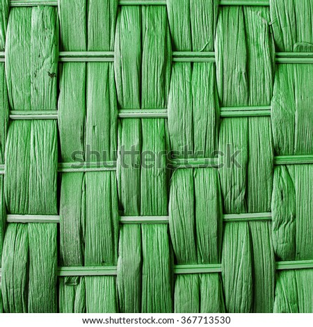 Imaginative green woven reed / wood / wooden abstract background texture. - stock photo