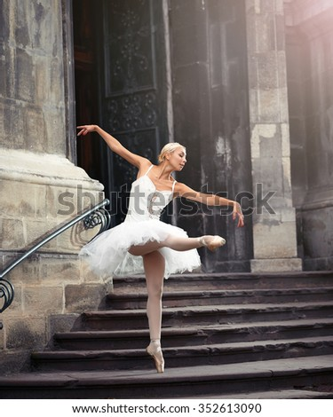 Imagine her performing. Full length shot of a talented ballerina dancing near an old castle  - stock photo