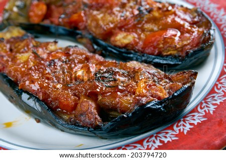 Imam bayildi - dishes found in Turkish cuisine.whole braised eggplant stuffed with onion, garlic and tomatoes, - stock photo