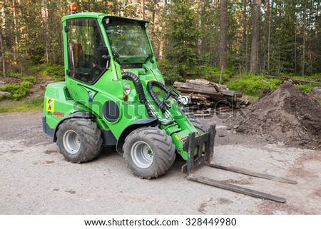Imatra, Finland - June 11, 2015: Green small forklift Avant 635 stands on a logging area