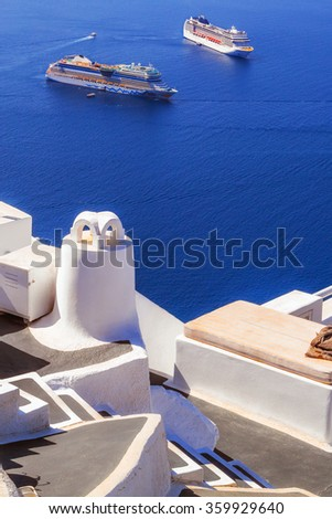 Imerovigli village architecture overlooking the cruise ships in the caldera, Santorini island, Greece - stock photo