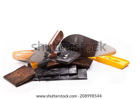 Imitation antique tiles,spatula, trowel, level on a white background - stock photo