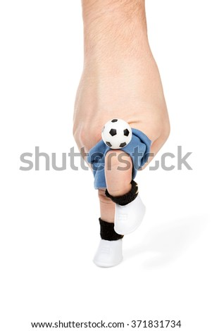 Imitation with your fingers football players juggling the ball using knee isolated on white background - stock photo
