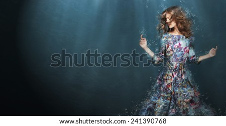 Immersion. Woman in Deep  Blue Sea. Fantasy - stock photo