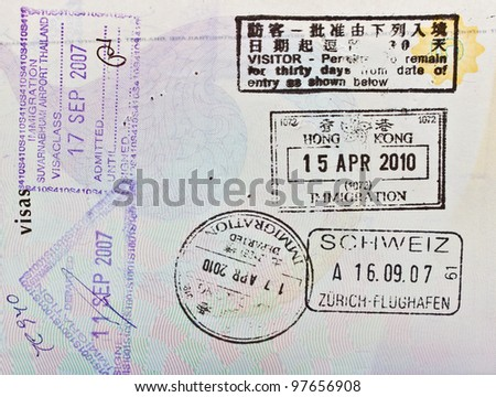 immigration stamps on passport - stock photo