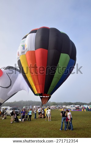 IMMOKALEE - APRIL 11: Colorful hot air ballons take flight on the morning of April 11, 2015 in Immokalee Florida. The town hosts an annual Balloons over Paradise festival - stock photo