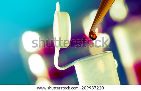 immunological research in the laboratory, test tubes and pipette - stock photo