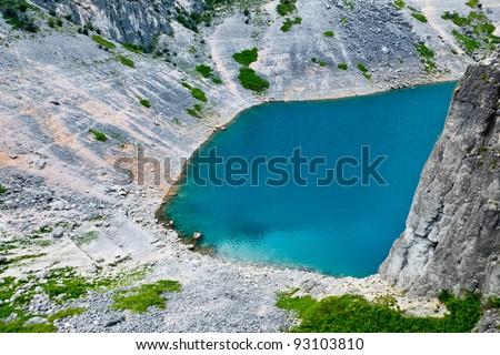 Imotski Blue Lake in Limestone Crater near Split, Croatia - stock photo