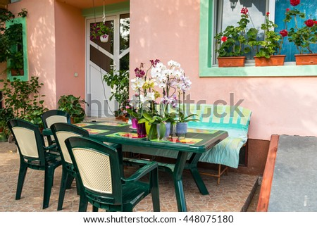 impatiens and orchids on the table outside
