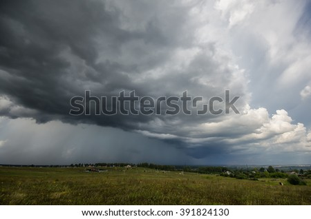 impending squall with rain,  impending hurricane, impending rain, approaching storm, Prairie Storm, the storm is coming, approaching storm, thunderstorm, tornado, mesocyclone, climate, Shelf cloud - stock photo