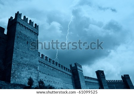 impenetrable wall under cloudy sky - stock photo