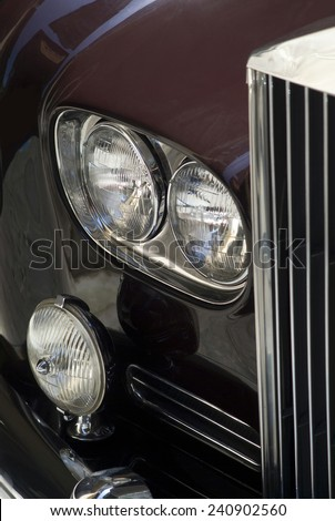IMPERIA, ITALY - JUNE 7, 2014: Close up detail of a Classic car cruising on the road in Imperia during raid of vintage cars. - stock photo