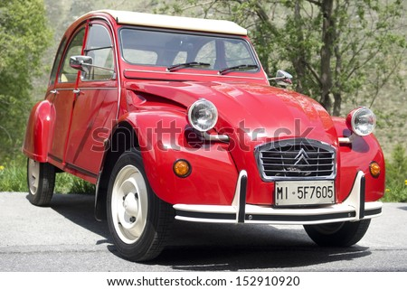 IMPERIA, ITALY � MAY 14: Close up of red Citroen car parked in a street in Imperia, Italy on May 14, 2011. - stock photo