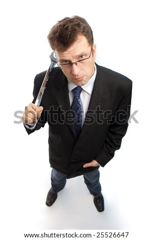 Impertinent businessman with steel wrench wait for something on white background