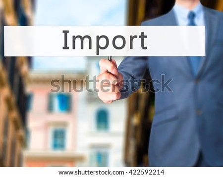 Import - Businessman hand holding sign. Business, technology, internet concept. Stock Photo - stock photo