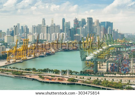 Import, Export, Logistics concept - Singapore cargo terminal,one of the busiest Import, Export, Logistics ports in the world, Singapore. Singapore is global commerce, finance and transport hub in Asia - stock photo