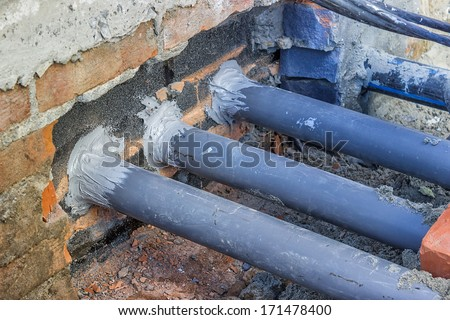 Importance of Rodent-Proof Construction, proper temporary rodent proofing. Seal all holes.Sealing gaps or holes with rodent-proof materials where pipes, wires,or other similar objects enter buildings. - stock photo