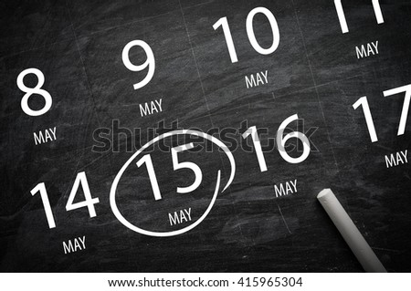Important Appointment: May 15 written on blackboard - stock photo
