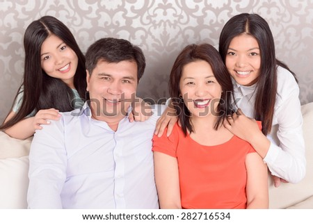 Important part. Portrait of Asian family at home.  - stock photo