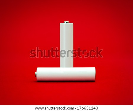 Important power source suggested by two white rechargeable batteries with room for text on them - stock photo