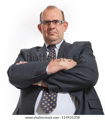 Imposing man in business attire with arms crossed - stock photo