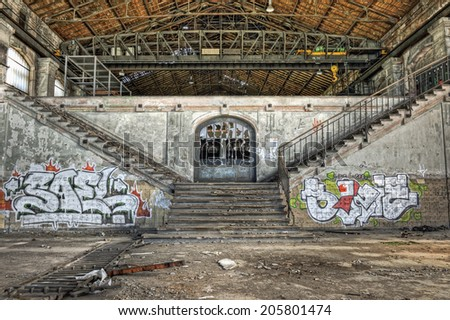 Imposing staircases inside the hall of an abandoned coal mine, HDR - stock photo