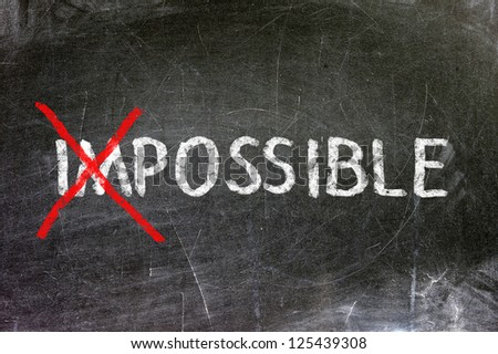 Impossible handwritten with white chalk on a blackboard. - stock photo