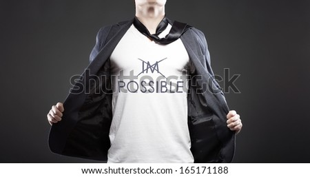 Impossible into possible with young successful businessman creative concept - stock photo
