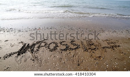IMPOSSIBLE with the letters IM cancelled in the sand of the beach