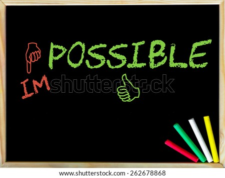 Impossible word changed into possible by red and green hand signs.Handwriting with chalk on wooden frame blackboard, colored chalk in the corner, Business Vision concept image - stock photo
