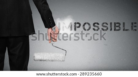 Impossible word painting on gray wall - stock photo