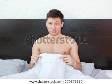 Impotent man worrying about his penis and erection failure , Surprised young man havingtrouble with potency and prostate - stock photo