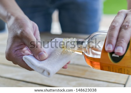 impregnate wooden table with oil