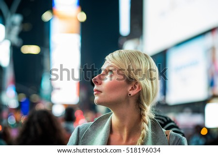 Impressed Woman in the Middle of Times Square at Night,