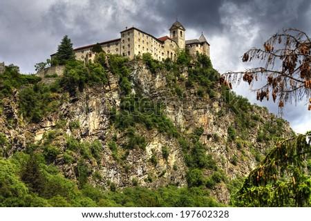 impressive castle on rock, north of Italy - stock photo