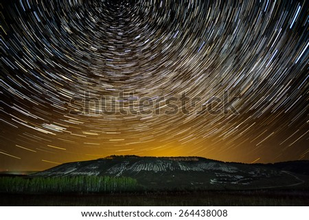 Impressive star tracks above Stenk-Izgorya protected area chalk hills in Belgorod region, southern Russia - stock photo