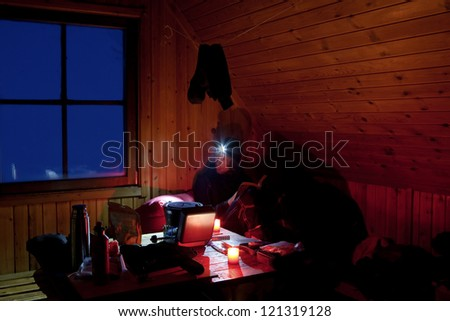 in a Cabin at night on the Kungsleden - stock photo