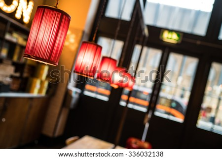 In a cafe next to the train platform at Kings Cross station. - stock photo