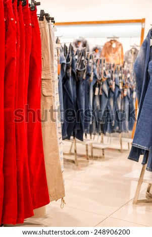 In a clothing store, shelves with goods.  - stock photo