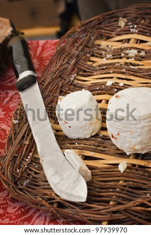 In a farmer's market this stand shows spicy goat cheese in a basket - stock photo